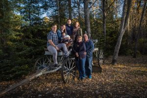A family poses at Centennial park for a Portrait session with BB Image. On a wagon